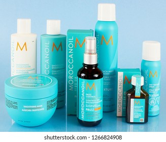 WEST PALM BEACH, FLORIDA - December 25, 2018: Illustrative editorial image of Moroccanoil brand of hair care products on blue background with reflection