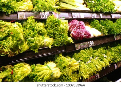 WEST PALM BEACH, FLORIDA - February 10, 2019:Photo of the inside of American grocery store's produce section showing lettuce greens and cabbage