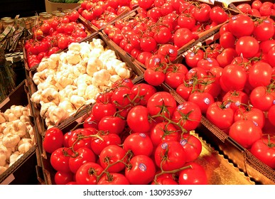 WEST PALM BEACH, FLORIDA - February 10, 2019:Photo of the inside of American grocery store's produce section showing tomatoes and garlic
