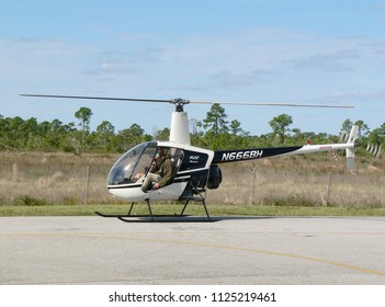 WEST PALM BEACH, FLORIDA - Jan 16, 2008. A Robinson R22 helicopter being used for civilian flight training. The instructor and student are unidentified.