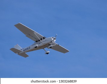 WEST PALM BEACH, FLORIDA - January 19, 2019:An overhead wing Cessna 4 seat aircraft taking off from an airport in Boca Raton, FL.