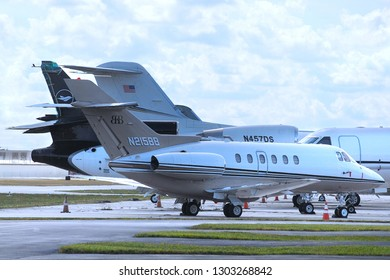 WEST PALM BEACH, FLORIDA - January 19, 2019:A Hawker 800 XP corporate jet owned by BBSI, Inc  is featured in a ramp shot showing multiple jets in Boca Raton, FL.