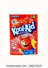 "WEST PALM BEACH, FLORIDA - January 29, 2015: A red packet of Kool-Aid cherry flavored drink mix. Kool-Aid, was invented in Hastings, Nebraska where locals still celebrate ""Kool Aid Days"" each August."