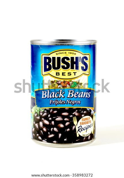 WEST PALM BEACH, FLORIDA - January 6, 2016: A can of Bush's black beans, also called frijoles negros. The label is blue and yellow with a photo of black beans and illustrated vegetables.