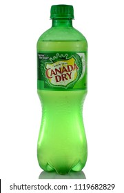 WEST PALM BEACH, FLORIDA - June 17, 2018: Illustrative editorial image of a green bottle of Canada Dry ginger ale on white background with reflection