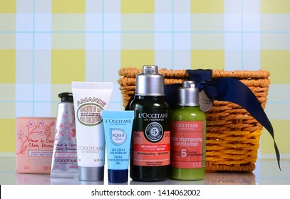 WEST PALM BEACH, FLORIDA - June 2, 2019: Illustrative ediotiral image of sample products from L'occitane en Provence that come in a gift basket. Hair and body products from France