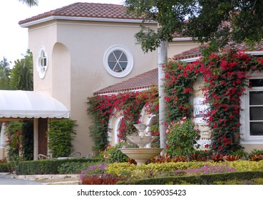 WEST PALM BEACH, FLORIDA - March 30, 2018: front of the beautiful White Horse Tavern covered with bougainville at the Palm Beach International Equestrian Center in Wellington, Florida