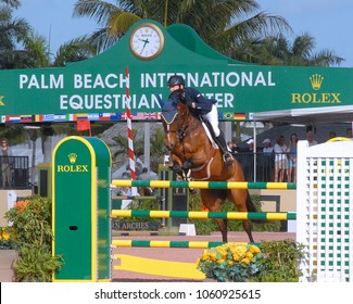 WEST PALM BEACH, FLORIDA - March 30, 2018: an unidentified horse and rider competing at week 12 of the Winter Equestrian Festival in Wellington, Florida