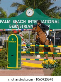 WEST PALM BEACH, FLORIDA - March 30, 2018: Luis Francisco de Acevedo and Colling competing at week 12 of the Winter Equestrian Festival in Wellington, Florida