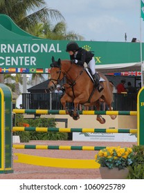 WEST PALM BEACH, FLORIDA - March 30, 2018: Katherine Dinan and Vic de Cerisiers competing at week 12 of the Winter Equestrian Festival in Wellington, Florida