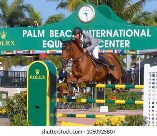 WEST PALM BEACH, FLORIDA - March 30, 2018: Francisco Jose Mesquita Musa and Sharapove Imperio Egipicia  competing to a win at week 12 of the Winter Equestrian Festival in Wellington, Florida