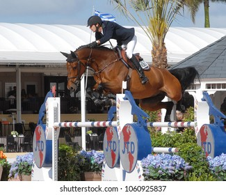 WEST PALM BEACH, FLORIDA - March 30, 2018:Pedro Junqueira Muylaert and C'est Doriijke competing at week 12 of the Winter Equestrian Festival in Wellington, Florida