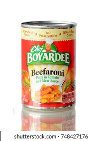 WEST PALM BEACH, FLORIDA - November 4, 2017: Nice Image of a r ed and green can of Chef Boyardee Beefaroni on white background sitting on reflective surface