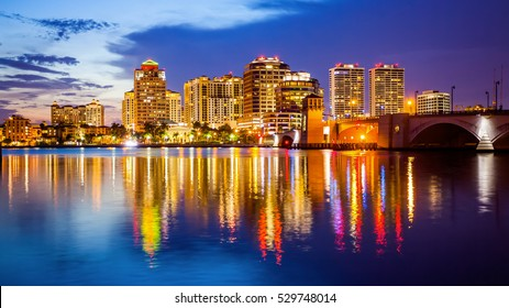 West Palm Beach, Florida skyline and city lights as night falls