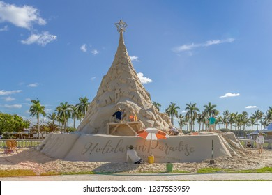 West Palm Beach, Florida, USA Nov 18, 2018 sand sculptors by a world-renowned group of sand sculptors, this famed holiday tree is strung with more than 5,000 real lights.