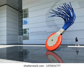 "WEST PALM BEACH, FLORIDA, USA - APRIL:  Norton Museum of Art entrance, with their signature ""Typewriter Eraser"" art work by Claes Oldenburg and Coosje van Bruggen as seen on April 13, 2019."