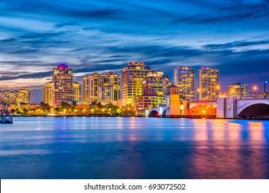 West Palm Beach, Florida, USA downtown skyline on the waterway.