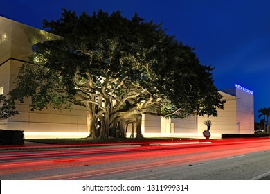 WEST PALM BEACH, FLORIDA/USA - FEBRUARY 12, 2019:  The newly opened Norton Museum of Art in downtown West Palm Beach, Florida, at night with traffic streaks, a high energy place.