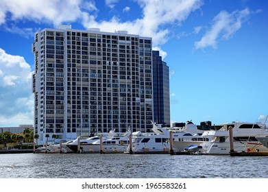 West Palm each, FloridaUSA - April 28, 2021:  Attractive yachts in a marina in downtown West Palm Beach, Florida adds to the beauty of the skyline and outdoor lifestyle.