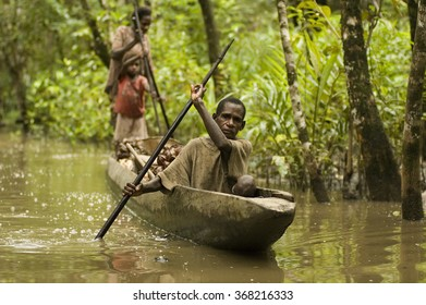 West Papua, Indonesia, Circa May 2011. Hunter gatherer Asmat people in a dugout canoe.