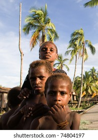 WEST PAPUA (IRIAN JAYA), ASMAT PROVINCE, INDONESIA - 19 JANUARY:  Daut, Yali, Den -  children of an  asmat tribe in a  small forest village on 19, january 2009 in West Papua, Indonesia.