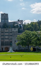 West Point, New York - August 30, 2019: Army military helicopter approaches parade field and bows to the spectators prior to a West Point Military Academy football game