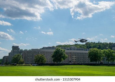 West Point, New York - August 30, 2019: Army military helicopter approaches parade field for maneuver demonstration prior to a West Point Military Academy football game