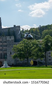 West Point, New York - August 30, 2019: Army military helicopter departs from the parade field after bowing to the spectators prior to a West Point Military Academy football game