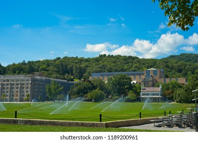 WEST POINT, NY - SEPTEMBER 4, 2018: A corner of the Plain lies before the MacArthur Barracks and the Superintendent House, with the Arvin Gym in back. The Plain is the parade field for the academy.