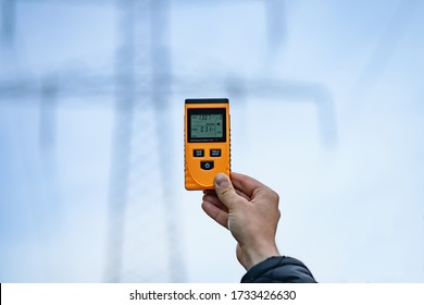 West Pomerania, Poland, near Szczecin, April 2020 - Electromagnetic radiation measuring under high voltage power transmission towers