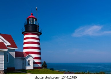 """West Quoddy Head lighthouse, referred to as the """"candy cane light"""" for its red and white striped tower, is located in the easternmost part of the United States, in Lubec, Maine."""