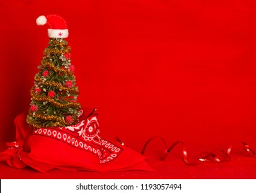 West Red Christmas card background with cowboy bandanna and holiday eve tree