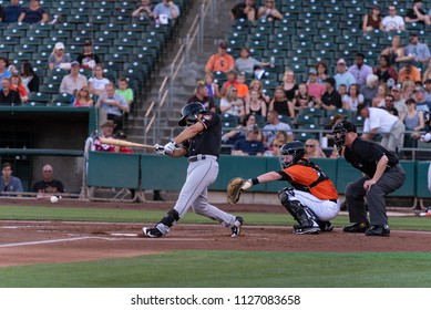 WEST SACRAMENTO, CA/U.S.A. - JUNE 29, 2018: Fresno Grizzlies Tim Federowicz hits the ball during a game against the River Cats at Raley Field.