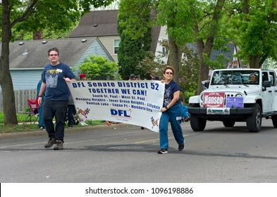 WEST SAINT PAUL, MN/USA – MAY 19, 2018: Members of Local Democratic-Farmer-Labor Party organizing unit hold sign and march in West Saint Paul Days parade followed by supporters of local candidate.