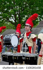 WEST SAINT PAUL, MN/USA – MAY 19, 2018: Students of Henry Sibley High School Marching Band percussion section lead parade during annual West Saint Paul Days festival.