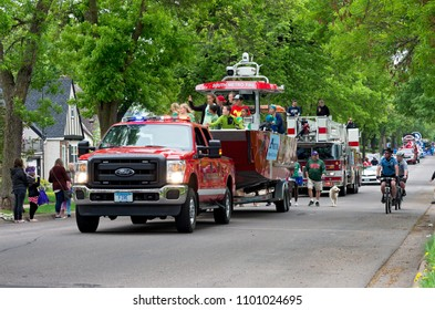 WEST SAINT PAUL, MN/USA – MAY 19, 2018: West Saint Paul Mayor Jenny Halverson leads procession aboard rescue boat at annual West Saint Paul Days parade.