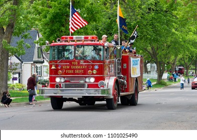 WEST SAINT PAUL, MN/USA – MAY 19, 2018: Scouts aboard fire truck during annual West Saint Paul Days Parade .