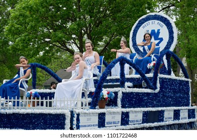 WEST SAINT PAUL, MN/USA – MAY 19, 2018: Royalty of West Saint Paul waves to crowd from atop float at annual West Saint Paul Days parade.