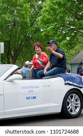 WEST SAINT PAUL, MN/USA – MAY 19, 2018: Parade Grand Marshall Pat Link waves to spectators from motorcade at annual West Saint Paul Days festival.