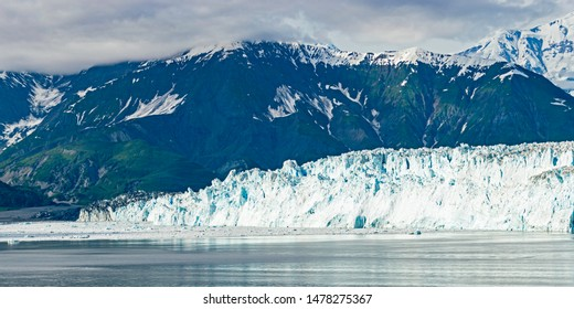 the west side of the hubbard glacier with valerie glacier on the far left side in disenchantment bay with the st elias mountains in the background