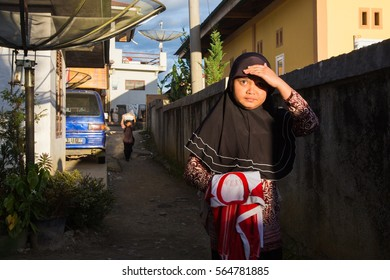 West Sumatera, Indonesia 14 April 2016: A girl heading with school uniform heading towards school
