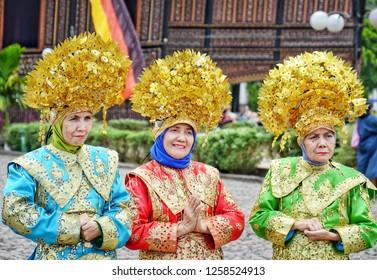WEST SUMATRA, Indonesia - DECEMBER 15, 2018 : Three women wearing traditional Minangkabau wedding dresses rented for photography in West Sumatra.