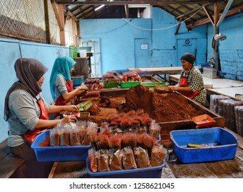 WEST SUMATRA, Indonesia - DECEMBER 16, 2018 : Female workers pack coffee powder in a factory in Tanah Datar, West Sumatra.
