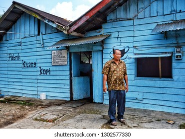 WEST SUMATRA, Indonesia - FEBRUARY 2, 2019 : Visitors come out of the coffee factory in Tanah Datar, West Sumatra.