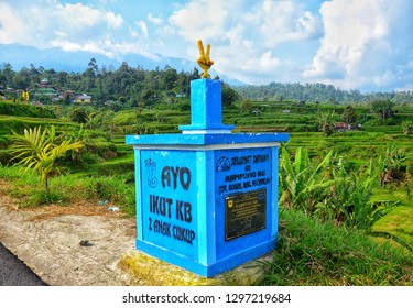 WEST SUMATRA, Indonesia - JANUARY 28, 2019 :  Sign stating 'Come on, two kids are enough', part of a long running family planning campaign in Nagari Pariangan, West Sumatra.