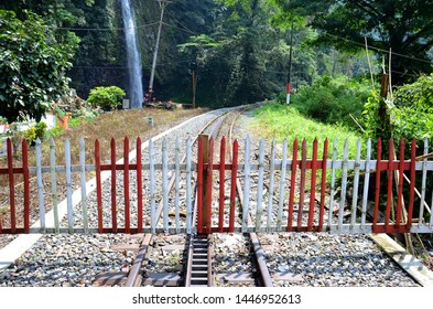WEST SUMATRA, Indonesia - JULY 10, 2019 : An old railway track which crisscrossed the main road in front of Lembah Anai Waterfall in West Sumatra.