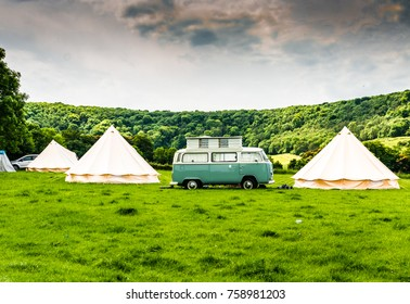 West Sussex, England - July 1, 2017: A VW Camper Van and tents at a camp site by the picturesque South Downs Way