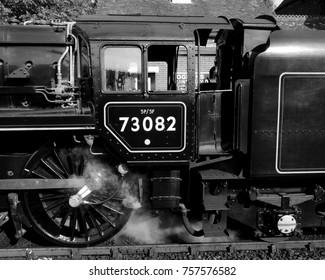 West Sussex, UK - 09/24/17: British Railways Standard Class 5MT 4-6-0 No 73082 'Camelot', built in 1955, at Sheffield Park Station on the Bluebell Railway.