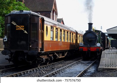 West Sussex, UK - 09/24/17: Pullman dining cars (left) and South Eastern and Chatham Railway (SE&CR) O1 Class 0-6-0 steam locomotive no 65 (right), at Sheffield Park Station on the Bluebell Railway.