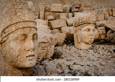 The west terrace of Mount Nemrut with heads of the colossal statues and the tumulus.   The UNESCO World Heritage Site at Mount Nemrut where King Antiochus of Commagene is reputedly entombed.